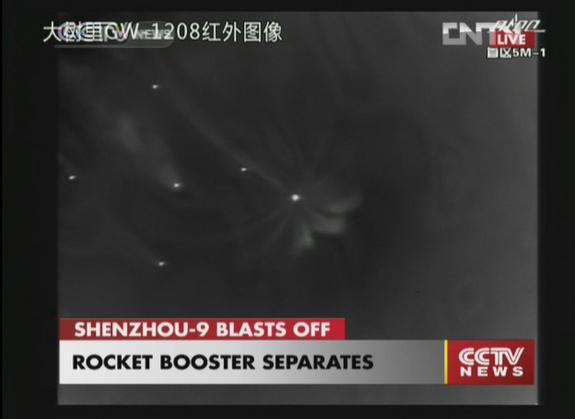 This spectacular view shows the rocket boosters separating as planned from China's Long March 2F rocket during the successful launch of Shenzhou 9 on June 16, 2012.