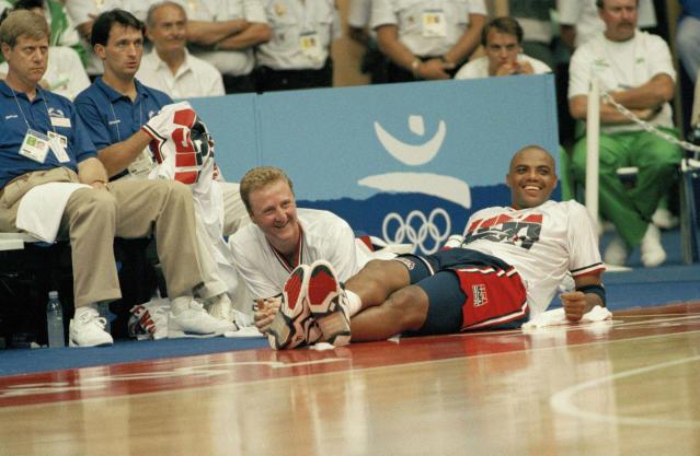 Team USA's Larry Bird, left, and Charles Barkley relax on the sidelines toward the end of the game against Brazil in Barcelona during the Summer Olympics, July 31, 1992. Barkley scored 30 points, the highest by a U.S. player in 11 pre-Olympic and Olympic games, in the 127-83 victory over Brazil. (AP Photo/Susan Ragan)