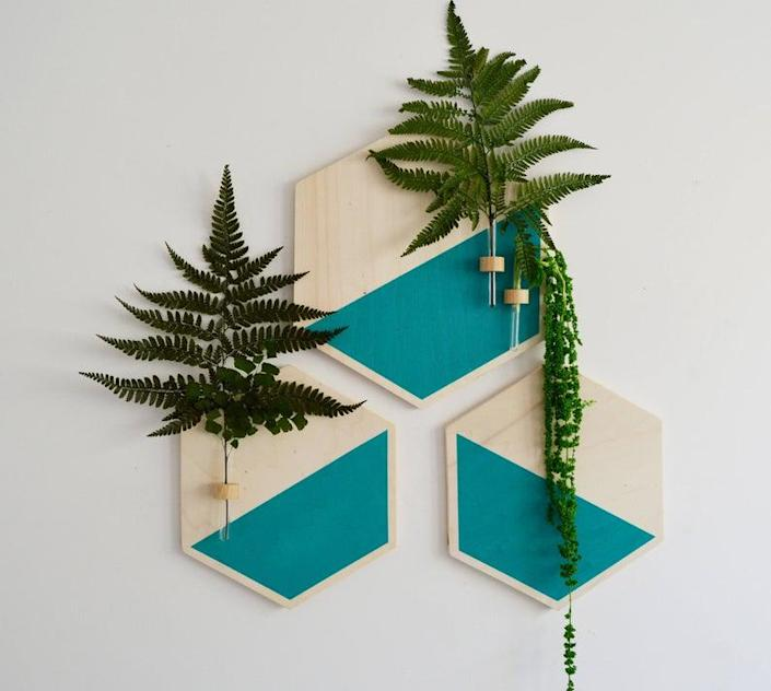 "These unique designs are the perfect repository for single stems cut from your favorite houseplants. Check out the Etsy store for plenty of other colors. $76, Etsy. <a href=""https://www.etsy.com/listing/522272678/hanging-planterwall-decorhanging"" rel=""nofollow noopener"" target=""_blank"" data-ylk=""slk:Get it now!"" class=""link rapid-noclick-resp"">Get it now!</a>"