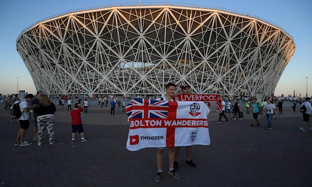 England fans gather outside the Volgograd Arena before kick-off against Tunisia. England's first game passed off without incident despite fears of violence.