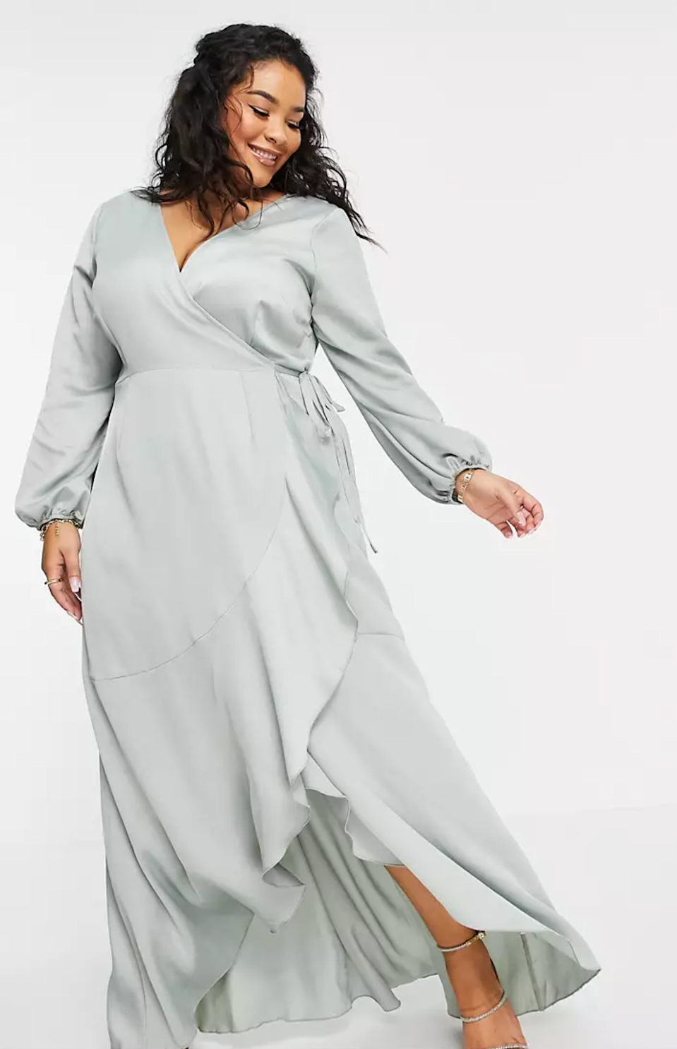 """This flowy ASOS number is both bridesmaid- and wedding-guest-appropriate—win-win! $87, ASOS. <a href=""""https://www.asos.com/us/little-mistress-plus/little-mistress-plus-wrap-tie-satin-midaxi-dress-in-sage-green/prd/22895875?colourwayid=60434660&SearchQuery=bridesmaid+dresses"""" rel=""""nofollow noopener"""" target=""""_blank"""" data-ylk=""""slk:Get it now!"""" class=""""link rapid-noclick-resp"""">Get it now!</a>"""