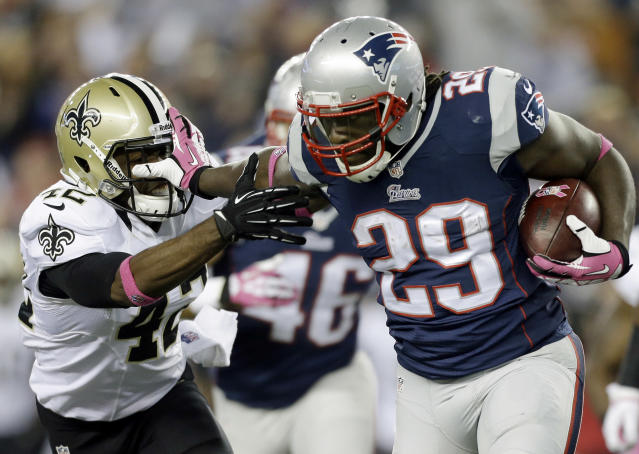 New England Patriots running back LeGarrette Blount (29) stiff-arm's New Orleans Saints free safety Isa Abdul-Quddus (42) as he runs for yardage in the third quarter of an NFL football game Sunday, Oct.13, 2013, in Foxborough, Mass. (AP Photo/Steven Senne)