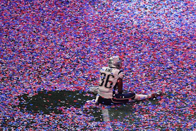<p>Brandon King of the New England Patriots sits in confetti on the pitch after winning Super Bowl LIII against the Los Angeles Rams at Mercedes-Benz Stadium in Atlanta, Georgia, on February 3, 2019. (Photo by Angela Weiss / AFP) </p>