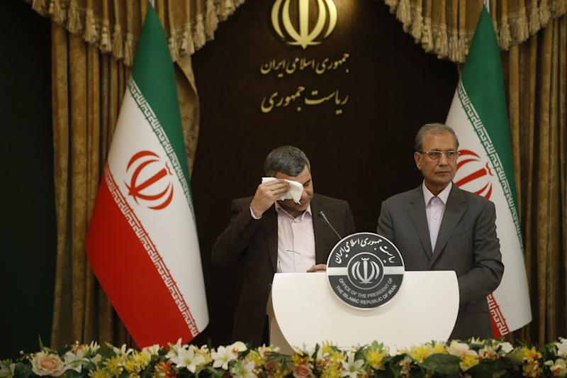 TEHRAN, IRAN - FEBRUARY 24: Iranian Deputy Health Minister Iraj Harirchi (L) wipes his sweating as he speaks on his tests positive for coronavirus as he holds a press conference with Iranian Government spokesman and Spokesperson for the Prevention and Struggle for Corona, created by Iranian President Hassan Rouhani, Ali Rabiei (R) in Tehran, Iran on February 24, 2020. (Photo by Stringer/Anadolu Agency via Getty Images)
