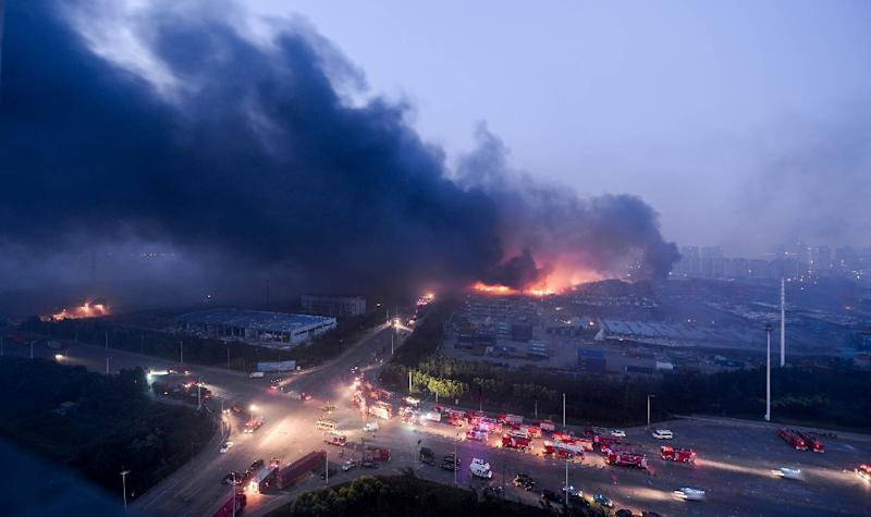 Fire and smoke can be seen on August 13, 2015 after massive explosions hit the Chinese city of Tianjin