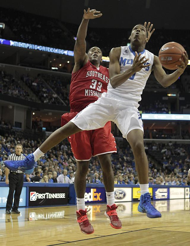 Memphis forward Nick King (5) goes to the basket against Southeast Missouri forward Tyler Stone (33) in the second half of an NCAA college basketball game on Saturday, Dec. 21, 2013, in Memphis, Tenn. (AP Photo/Lance Murphey)