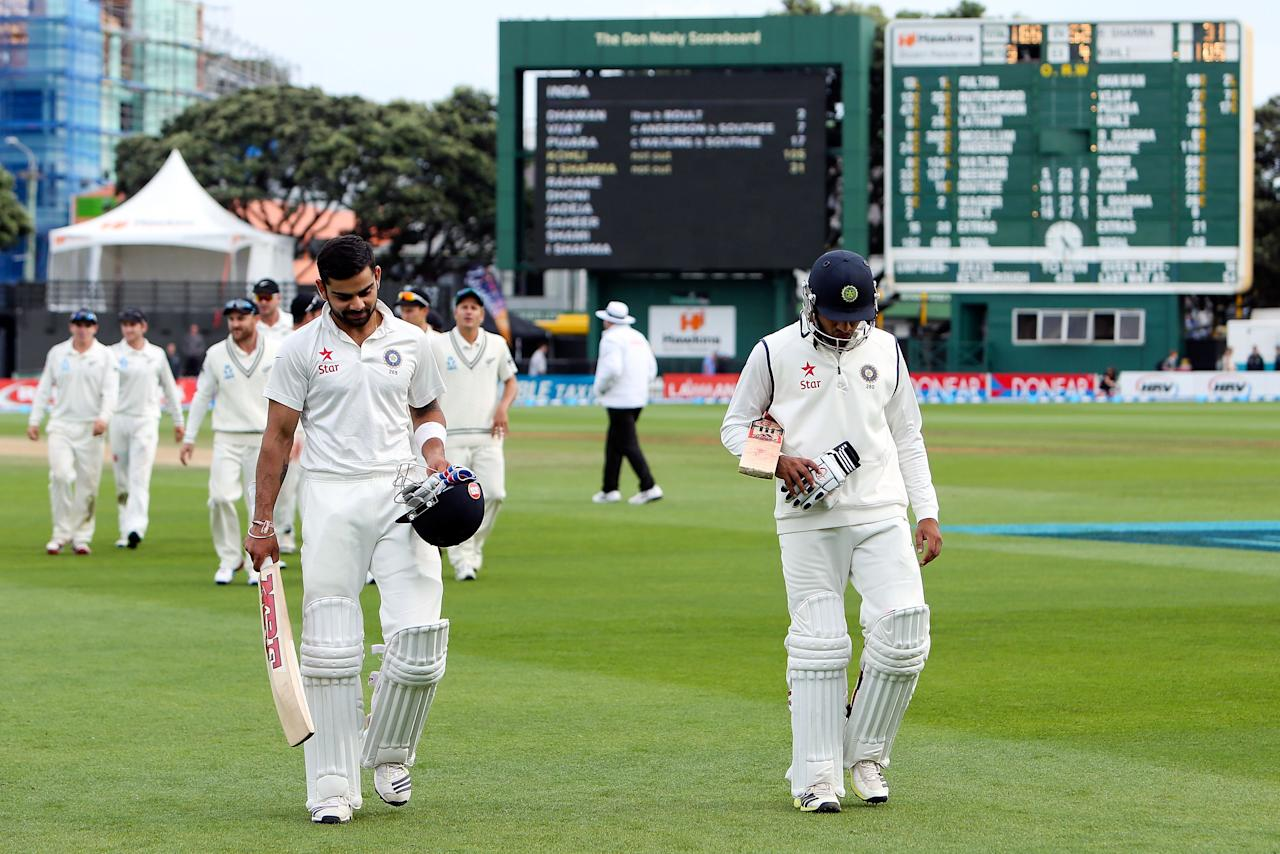 WELLINGTON, NEW ZEALAND - FEBRUARY 18:  Virat Kohli (L) and Rohit Sharma of India leave the field at the end of the match during day five of the 2nd Test match between New Zealand and India on February 18, 2014 in Wellington, New Zealand.  (Photo by Hagen Hopkins/Getty Images)