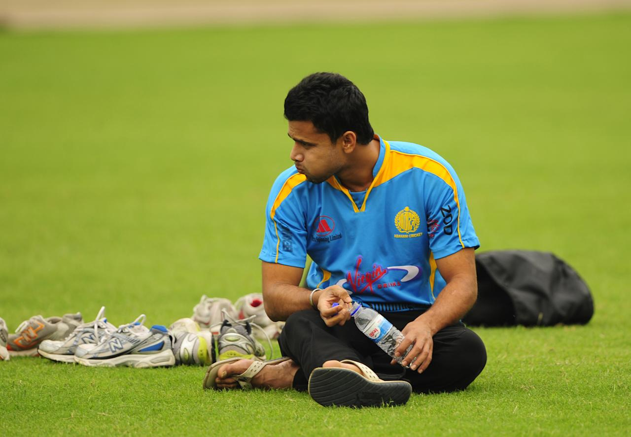 Bangladeshi cricketer Mashrafe Bin Mortaza sits on the ground during a practice session at The Sher-e Bangla National Stadium in Dhaka on February 21, 2011.