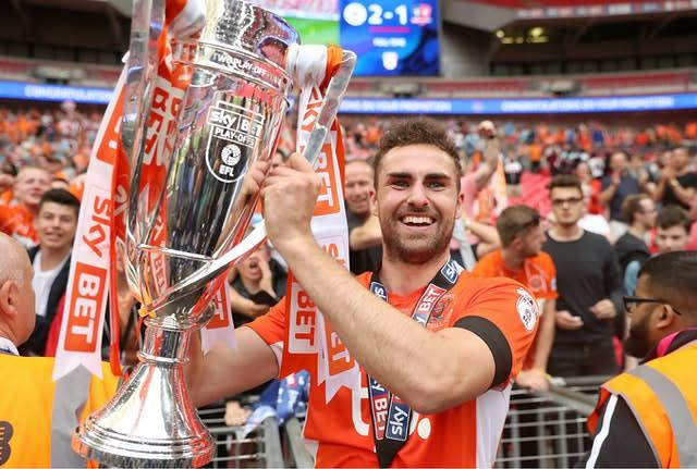 Blackpool's Clark Robertson celebrates with the trophy (Adam Davy/PA)