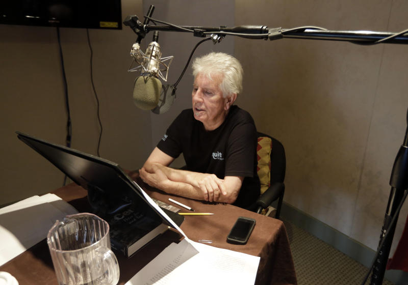 "Singer Graham Nash prepares during the recording session for the audio book version of his ""Wild Tales: A Rock & Roll Life"" autobiography, in New York, Thursday, July 25, 2013. (AP Photo/Richard Drew)"