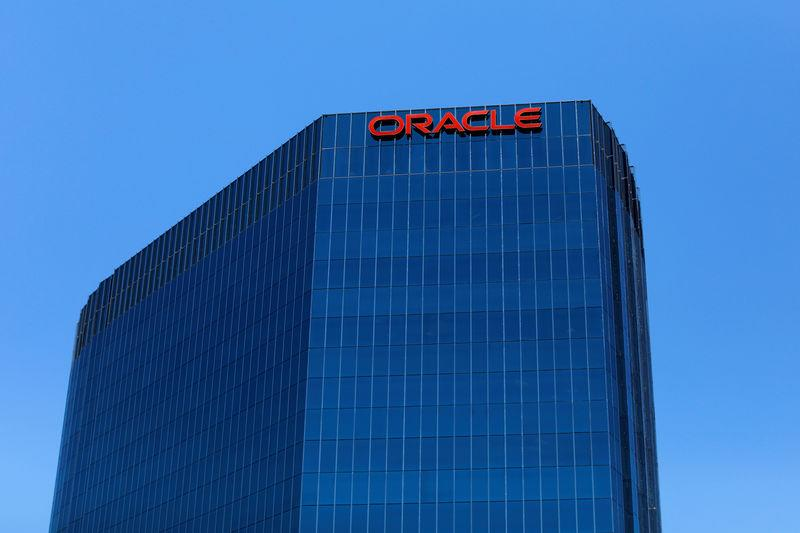 FILE PHOTO: The Oracle logo is shown on an office building in Irvine, California, U.S. June 28, 2018. REUTERS/Mike Blake