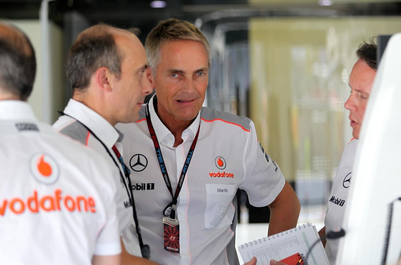 McLaren's CEO Martin Whitmarsh (centre) during qualifying day for the 2013 Italian Grand Prix at the Autodromo di Monza in Monza, Italy.