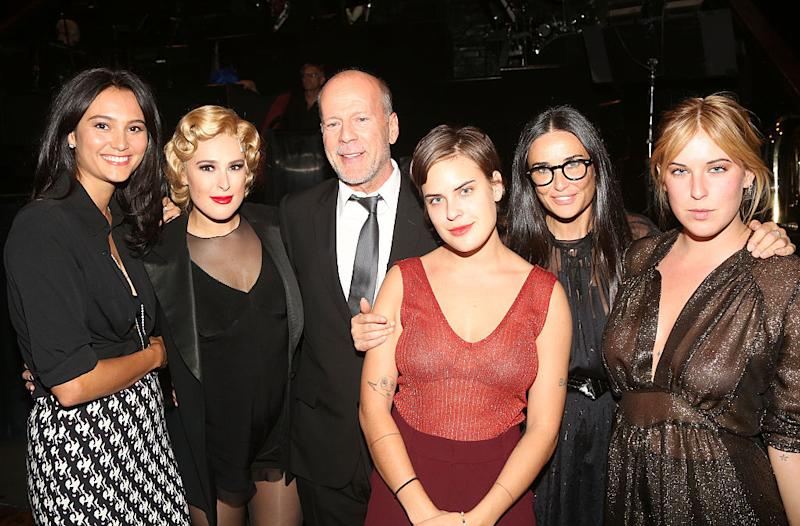 "Demi Moore said she's ""proud"" of her divorce from ex-husband Bruce Willis and the relationship they've built (From left to right, Emma Heming Willis, Rumer Willis, Bruce Willis, Tallulah Willis, Demi Moore and Scout Willis). Image via Getty Images."