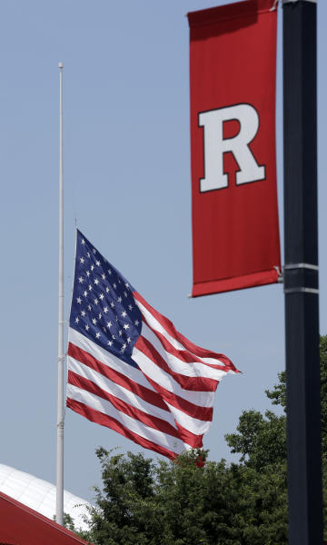 """The flag flies half-staff at Rutgers Universty Monday, June 24, 2013, in Piscataway, N.J., after Gov. Chris Christie ordered the lowering in memory of """"Sopranos"""" star, Rutgers alumnus and New Jersey native James Gandolfini. The flag directive issued Friday by Christie says Gandolfini was an iconic actor who """"left a timeless impact upon television and film in the state of New Jersey and across our nation."""" (AP Photo/Mel Evans)"""