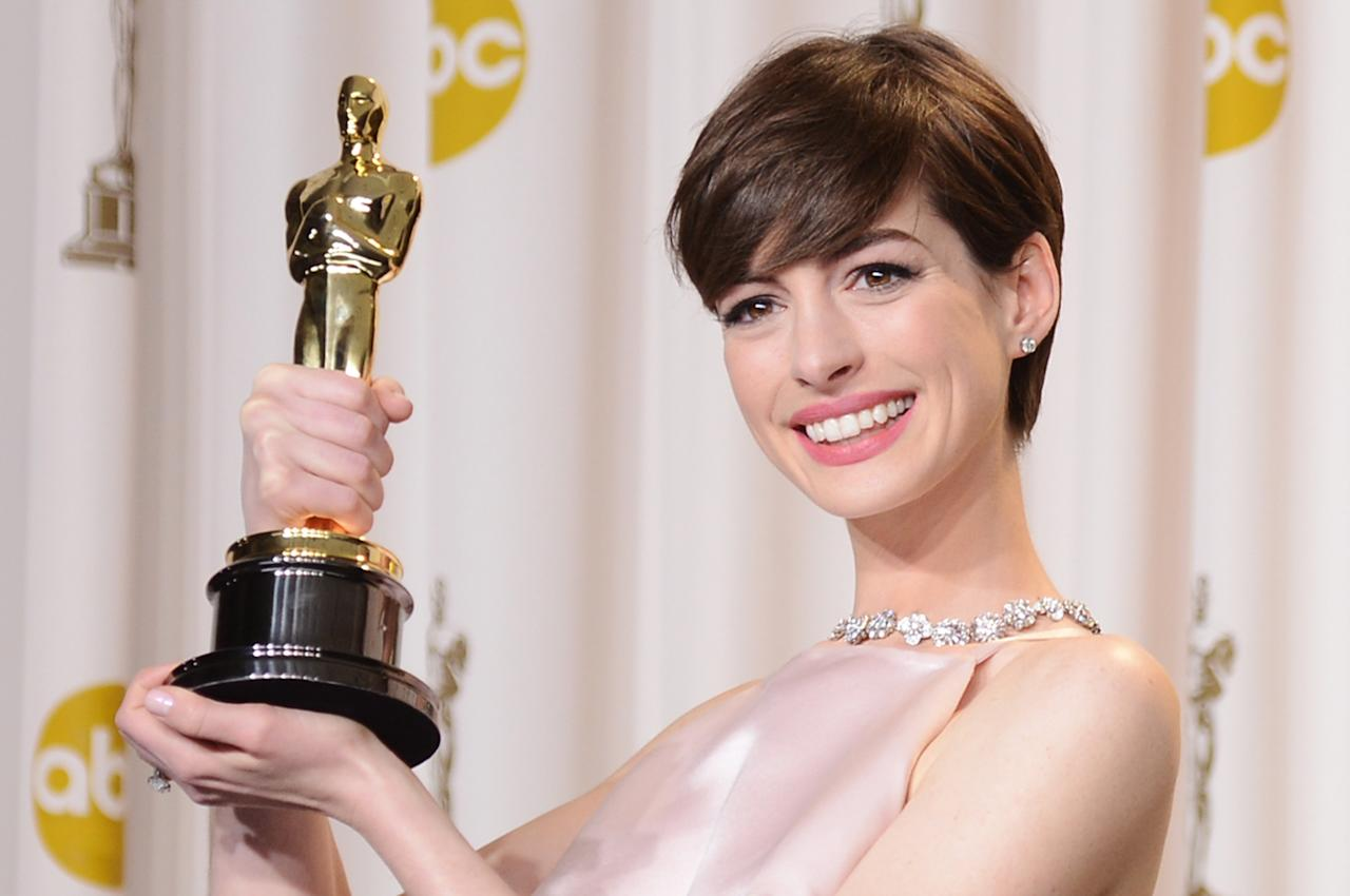 "HOLLYWOOD, CA - FEBRUARY 24:  Actress Anne Hathaway, winner of the Best Supporting Actress award for ""Les Miserables,"" poses in the press room during the Oscars held at Loews Hollywood Hotel on February 24, 2013 in Hollywood, California.  (Photo by Jason Merritt/Getty Images)"