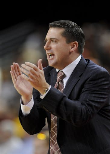 Southern Cal interim head coach Bob Cantu yells his player on during the first half of an NCAA college basketball game against Oregon State, Saturday, Jan. 19, 2013, in Los Angeles. (AP Photo/Gus Ruelas)