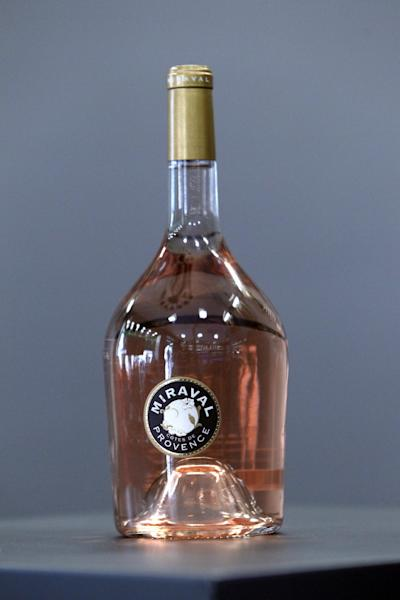 """CAPTION CORRECTS NAME OF BOTTLE FROM MIRAMAR TO MIRAVAL A bottle of Miraval 2013 is pictured in Paris, Friday, Jan.31, 2014. The latest Brad Pitt-Angelina Jolie sequel is being described as powerful and elegant with a """"mouthwatering finish."""" These raves don't appear in Hollywood bible Variety _ they're from Decanter magazine's review of the celebrity couple's second vintage of rose wine produced at their Provencal estate Chateau Miraval. The 2013 Miraval goes on sale online Friday and will be in shops and restaurants around the world next month. (AP PhotoThibault Camus)"""