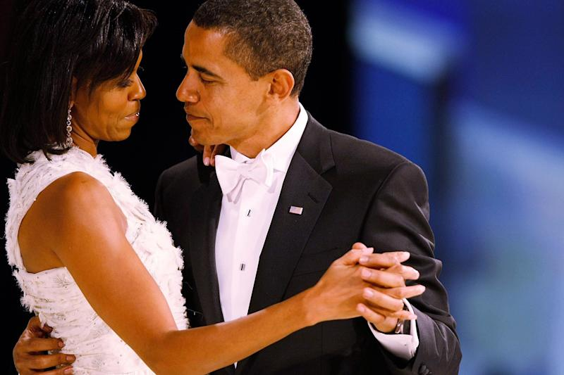 President Barack Obama dances with his wife and first lady Michelle Obama during the Western Inaugural Ball on Jan. 20, 2009 in Washington, DC.