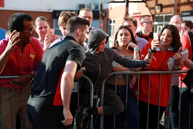 """Soccer Football - Premier League - AFC Bournemouth vs Manchester United - Vitality Stadium, Bournemouth, Britain - April 18, 2018 Bournemouth's Lewis Cook poses for photographs with fans outside the stadium before the match REUTERS/Ian Walton EDITORIAL USE ONLY. No use with unauthorized audio, video, data, fixture lists, club/league logos or """"live"""" services. Online in-match use limited to 75 images, no video emulation. No use in betting, games or single club/league/player publications. Please contact your account representative for further details."""