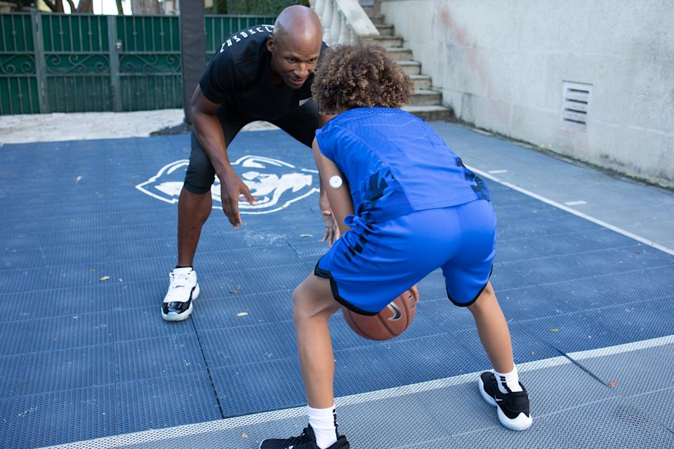Walker Allen plays basketball with his father Ray Allen.