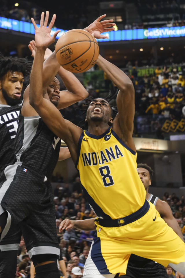 Indiana Pacers forward Justin Holiday (8) loses the ball in front of Sacramento Kings guard Yogi Ferrell (3) during the second half of an NBA basketball game in Indianapolis, Friday, Dec. 20, 2019. The Pacers won 119-105. (AP Photo/AJ Mast)