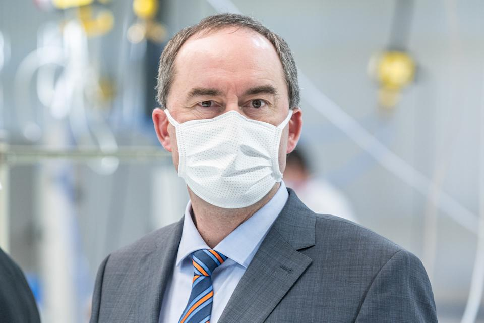 02 April 2020, Bavaria, Weng: Hubert Aiwanger (Independent Voter), Bavaria's Minister of Economic Affairs, stands with a face mask in a production hall of the automotive supplier Zettl. In view of the corona crisis, the company has switched its operations to the production of protective masks. Photo: Armin Weigel/dpa (Photo by Armin Weigel/picture alliance via Getty Images)