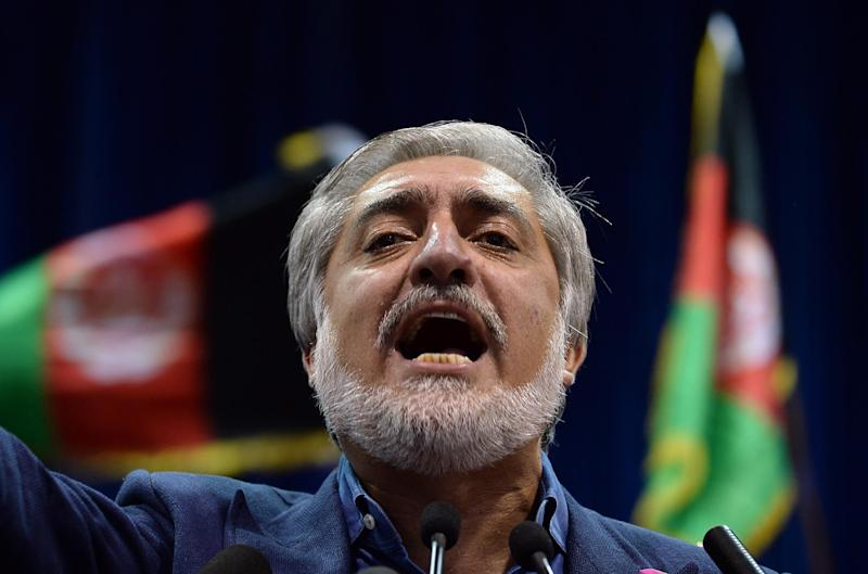 Afghan presidential candidate Abdullah Abdullah speaks at a rally in Kabul on July 8, 2014 (AFP Photo/Shah Marai)
