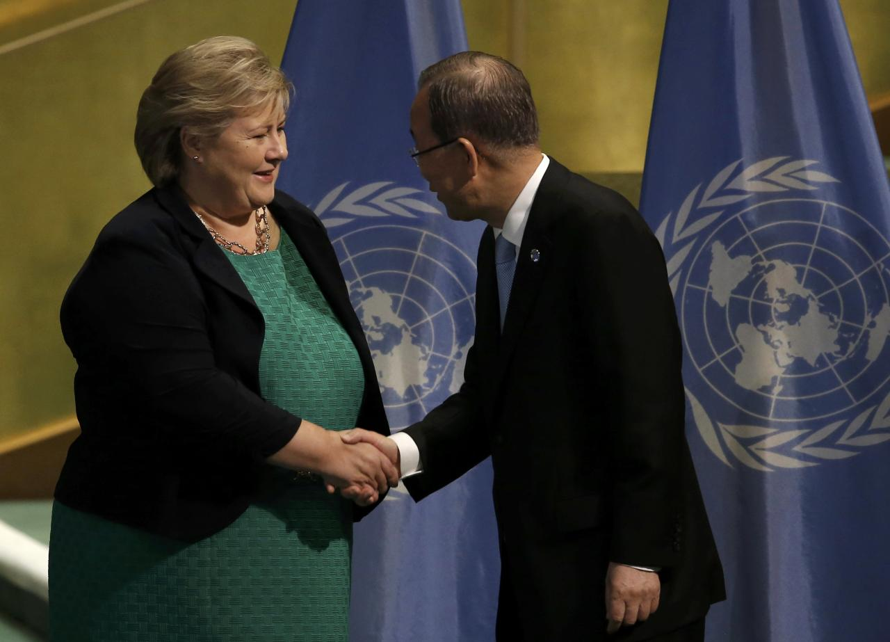 """Prime Minister Erna Solberg of Norway shakes hands with U.N. Secretary General Ban Ki-moon (R), who was acknowledging states that have ratified the Paris Agreement at a """"High-Level Event on Entry into Force of the Paris Agreement on Climate Change"""" meeting at United Nations headquarters in the Manhattan borough of New York, U.S., September 21, 2016.  REUTERS/Mike Segar"""