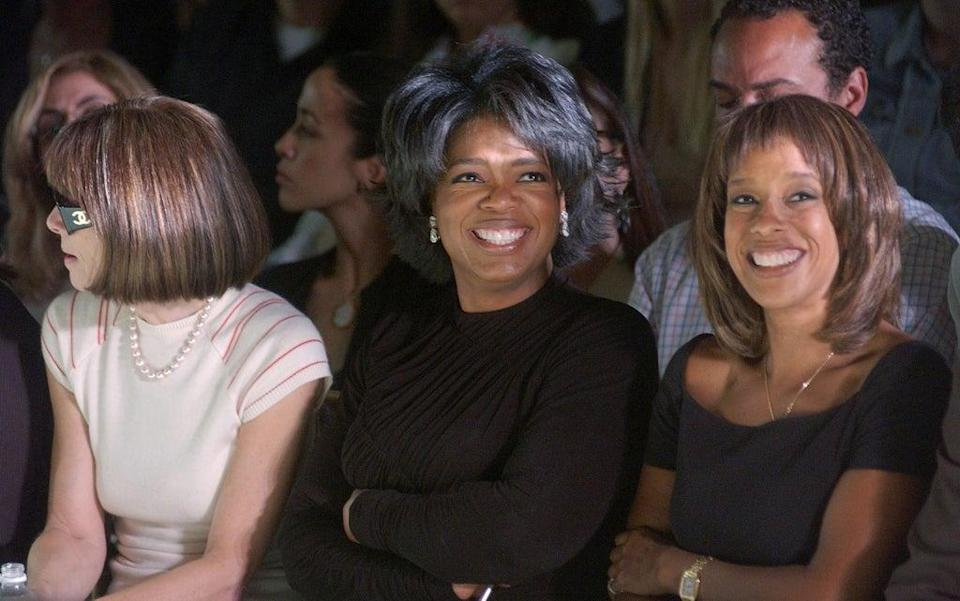 Talk show host Oprah Winfrey (C), Vogue editor Anna Wintour (L) and Oprah Magazine editor Gayle King attend the Vera Wang Spring/Summer 2003 Collection at the New York Public Library for Mercedes-Benz Fashion Week September 20, 2002 (Getty Images)
