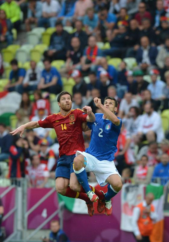 Spanish midfielder Xabi Alonso (L) vies with Italian defender Christian Maggio during the Euro 2012 championships football match Spain vs Italy on June 10, 2012 at the Gdansk Arena. AFP PHOTO / GABRIEL BOUYSGABRIEL BOUYS/AFP/GettyImages