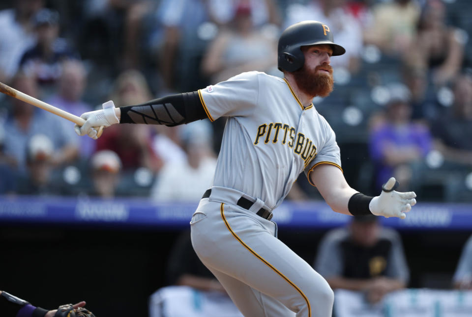 Pittsburgh Pirates' Colin Moran follows the flight of his RBI-single off Colorado Rockies relief pitcher Jairo Diaz in the ninth inning of a baseball game Sunday, Sept. 1, 2019, in Denver. Pittsburgh won 6-2. (AP Photo/David Zalubowski)