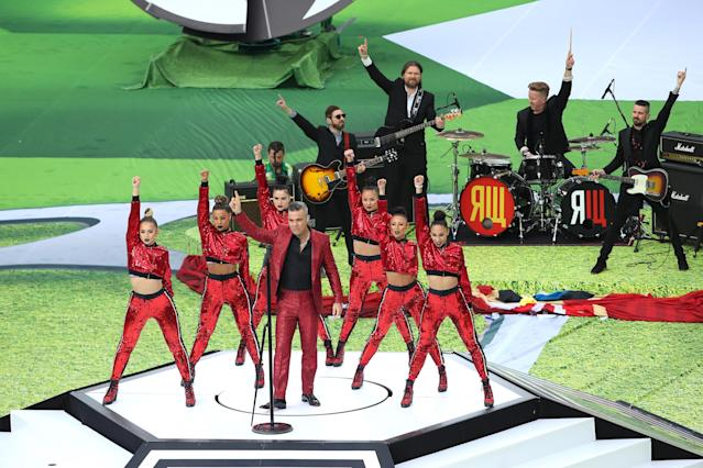 <p>Let him entertain you: Robbie Williams warms up the crowd at the Luzhniki Stadium. (Getty) </p>