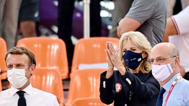 PHOTO: First Lady Jill Biden applauds next to French President Emmanuel Macron  while attending the Women's first round 3x3 basketball match between US and France at the Aomi Urban Sports Park in Tokyo, on July 24, 2021. (Andrej Isakovic/AFP via Getty Images)
