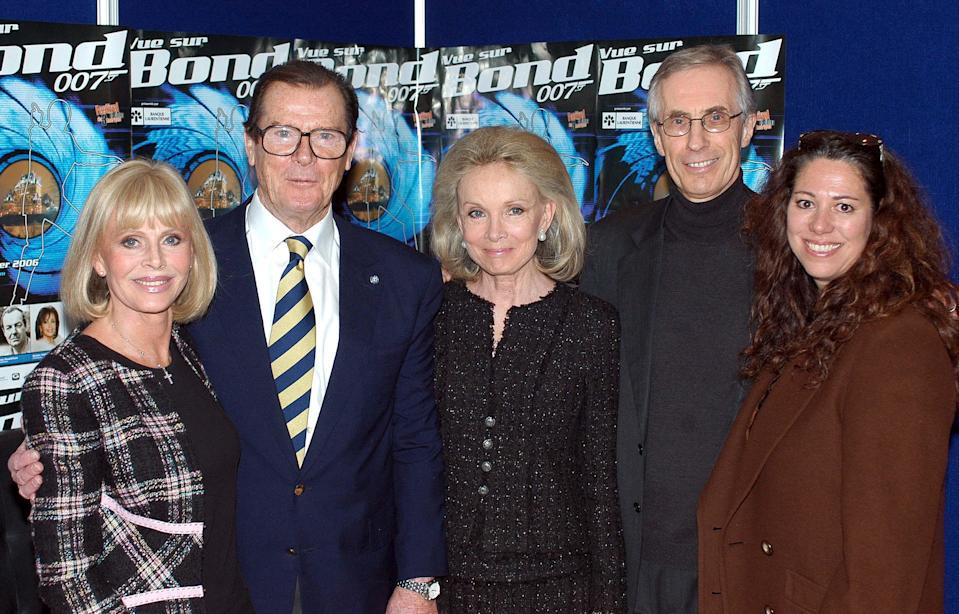 """CANADA - FEBRUARY 24:  Seven times James Bond Roger Moore in Quebec, Canada on February 24, 2006-On the picture: Britt Ekland (Bond girl), Sir Roger Moore, Kristina Tholstrup (Moore's wife), Nigel Fisher (President and CEO of Unicef Canada), Hilary Saltzman (Harry Saltzman's daughter, former Bond producer). Quebec City is spellbound by """"Vue sur Bond 007"""", an unprecedented event that is feature Sir Roger Moore and a host of celebrities and artists who were involved in the filmography of the famous British secret agent. The project was designed and produced to spotlight the contribution of Harry Saltzman, one of the most important producers of this series who also happens to have Quebec roots. The project also aims to raise funds for the 7th edition of the 3 Americas Film Festival and UNICEF through cultural and sports activities.  (Photo by Jean-Philippe DUMAS/PONOPRESSE/Gamma-Rapho via Getty Images)"""