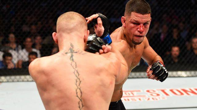 Diaz throws a punch at McGregor. Pic: Getty