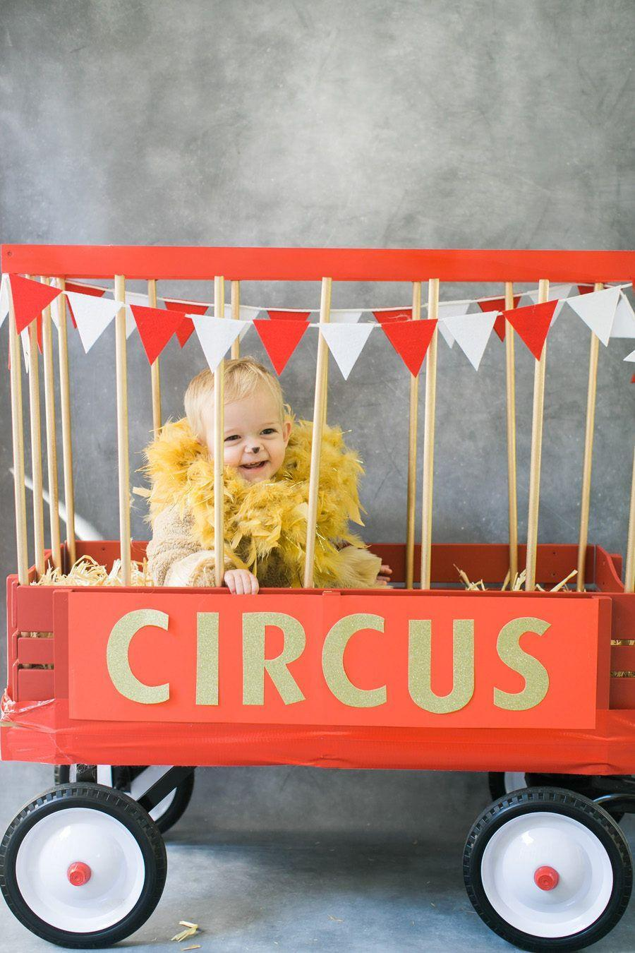 """<p>Your fierce little lion will feel warm and cozy in a furry snowsuit and feather boa mane. Put him inside his very own circus wagon for easy transport while trick-or-treating. </p><p><strong>See more at <a href=""""https://www.stylemepretty.com/living/2015/10/07/diy-halloween-costume-circus-lion/"""" rel=""""nofollow noopener"""" target=""""_blank"""" data-ylk=""""slk:Style Me Pretty"""" class=""""link rapid-noclick-resp"""">Style Me Pretty</a>. </strong></p><p><a class=""""link rapid-noclick-resp"""" href=""""https://www.amazon.com/Amscan-Costume-Party-Feather-Accessory/dp/B01BHFWORS?tag=syn-yahoo-20&ascsubtag=%5Bartid%7C10050.g.29402076%5Bsrc%7Cyahoo-us"""" rel=""""nofollow noopener"""" target=""""_blank"""" data-ylk=""""slk:SHOP GOLD FEATHER BOAS"""">SHOP GOLD FEATHER BOAS</a></p>"""