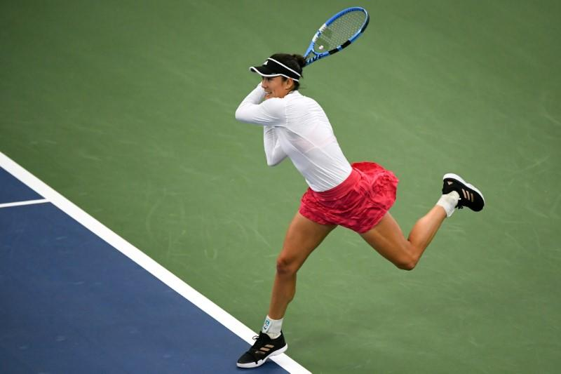 Muguruza shakes off rust to reach U.S. Open second round