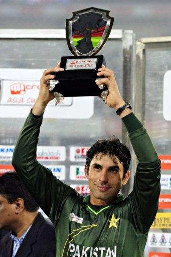 Pakistani cricket team captain Misbah-ul-Haq holds the champion trophy following the one day international (ODI) Asia Cup cricket final match between Bangladesh and Pakistan at The Sher-e-Bangla National Cricket Stadium in Dhaka