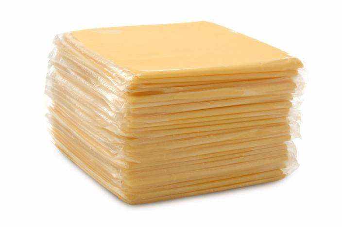 A stack of wrapped processed cheese slices