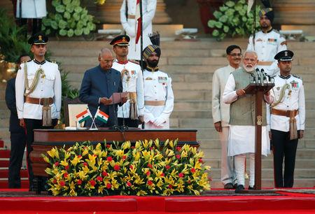 India's President Ram Nath Kovind administers oath of India's Prime Minister Narendra Modi during a swearing-in ceremony at the presidential palace in New Delhi, India May 30, 2019. REUTERS/Adnan Abidi
