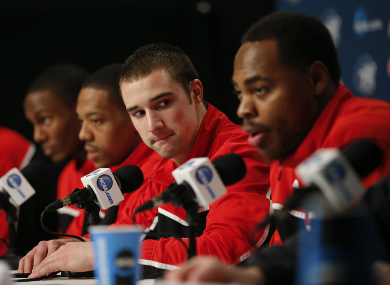Ohio State's Aaron Craft, center, listens to Deshaun Thomas, right, during a news conference in Los Angeles, Friday, March 29, 2013. Ohio State plays Wichita State in the West Regional finals of the NCAA college basketball tournament Saturday. (AP Photo/Jae C. Hong)