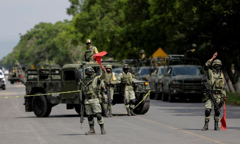 Members of the national guard are seen at a checkpoint after the capture of José Antonio 'El Marro' Yépez.