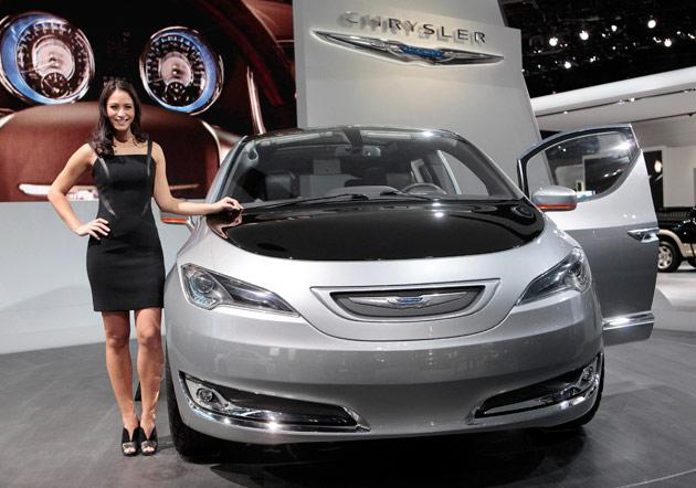 Model Tiffany Stone stands next to the Chrysler 700 C concept van as it is displayed on the final press preview day for the North American International Auto Show in Detroit, Michigan, January 10, 2012.  REUTERS/Rebecca Cook