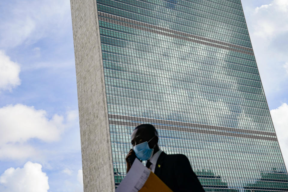 A pedestrian passes outside the United Nations headquarters, Tuesday, Sept. 21, 2021, during the 76th Session of the U.N. General Assembly in New York. (AP Photo/John Minchillo, Pool)