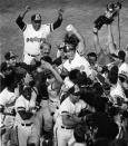 FILE - In this Oct. 6, 1984, file photo, San Diego Padres Steve Garvey, center, is carried triumphantly off the field by his teammates after hitting a game-winning home run in the ninth inning to beat the Chicago Cubs, in Game 4 of the National League Playoffs in San Diego. The biggest piece of San Diego's sports history is slowly being knocked down and ground to bits. Now the stadium is coming to an unceremonious end, leaving generations of fans feeling melancholy because, due to the coronavirus pandemic, they didn't get to say a proper goodbye to the place where they tailgated with gusto in the massive parking lot before cheering on the Chargers, Padres and Aztecs, or watched myriad other events and concerts. (AP Photo/File)