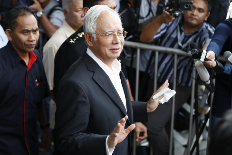 Former Malaysian premier Najib arrested, to be charged Wednesday
