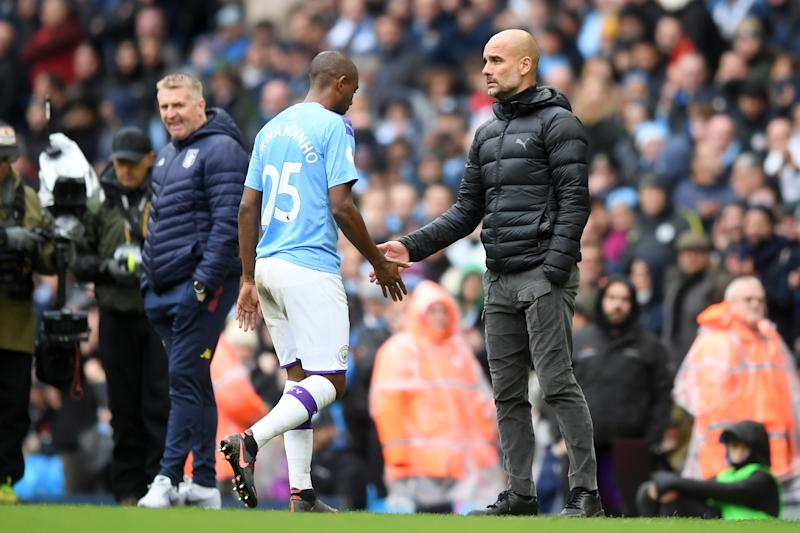 MANCHESTER, ENGLAND - OCTOBER 26: Pep Guardiola, Manager of Manchester City greets Fernandinho of Manchester City as he leaves the pitch after receiving a red card during the Premier League match between Manchester City and Aston Villa at Etihad Stadium on October 26, 2019 in Manchester, United Kingdom. (Photo by Michael Regan/Getty Images)
