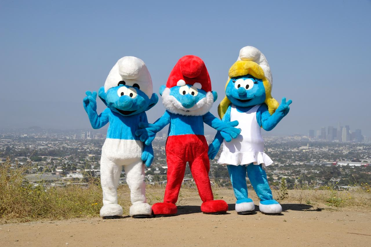 LOS ANGELES, CA - JUNE 22: Smurfette, Papa Smurf and Clumsy Smurf attend the Global Smurfs Day celebration in Los Angeles on June 22, 2013 in Los Angeles, California. (Photo by John Sciulli/Getty Images for Sony Pictures Entertainment)