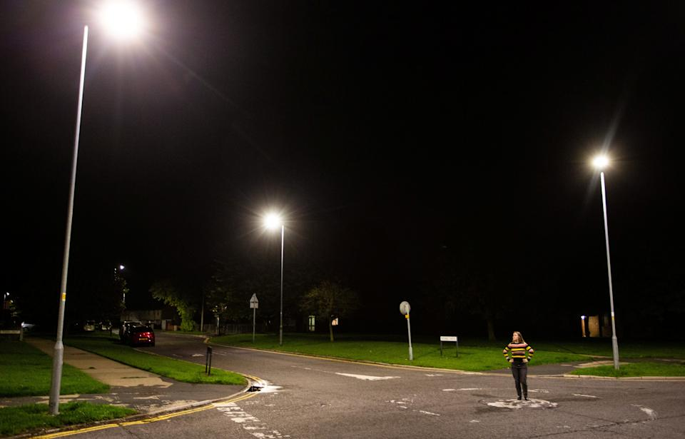 A pedestrian looks up at the new street lights in Swindon, which have been keeping some residents up at night. (SWNS)