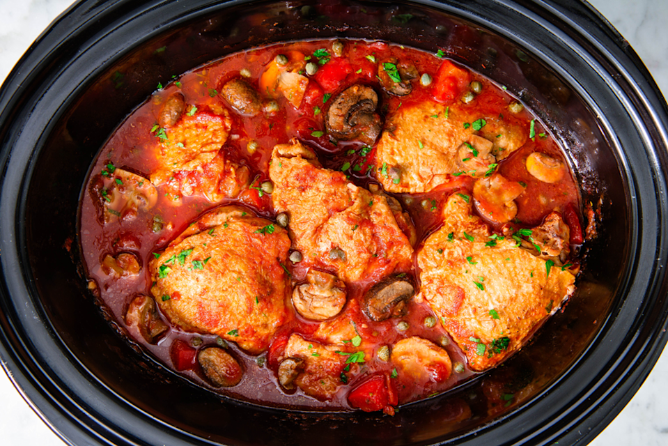 """<p>Watch yourself get fancy with the slow cooker as you master this mouth-watering Italian cuisine. The prep time takes about 10 minutes, and when the chicken is just about done cooking in the tomatoes and spices, all you have to do is cook the linguine.</p><p><em><a href=""""https://www.delish.com/cooking/recipe-ideas/a23106011/slow-cooker-chicken-cacciatore-recipe/"""" rel=""""nofollow noopener"""" target=""""_blank"""" data-ylk=""""slk:Get the recipe from Delish »"""" class=""""link rapid-noclick-resp"""">Get the recipe from Delish »</a></em></p>"""